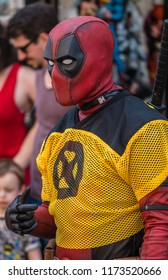 Rochester, England -  July 2018 : Man dressed as Deadpool character in costume promoting comic shop