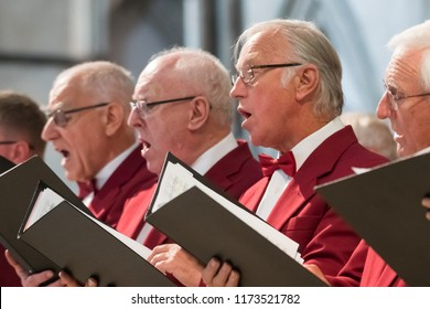 Rochester, England -  July 2018 : Mens choir performing in a cathedral, Kent, UK