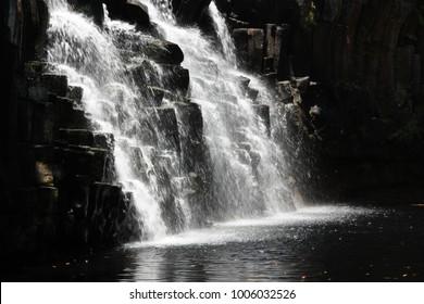 Rochester Falls, Soulliac, Mauritius, Africa.Beautiful water splashes on stone cascades.