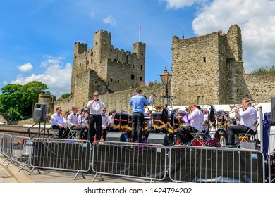 Rochester, Kent, UK. 03rd June, 2018. Credit: Picture That / Alamy Live News. BAE brass band plays in front of Rochester castle at the anual Rochester Dickens festival