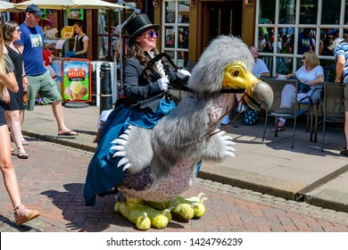 Rochester, Kent, UK. 03rd June, 2018. Credit: Picture That / Alamy Live News. Participant in Victorian costume rides a dodo at the anual Rochester Dickens festival