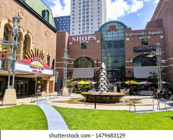 ROCHESTER, MINNESOTA - AUGUST 2, 2019:  University Square shops located downtown next to urban public park plaza with green space, theater, fountain and restaurants
