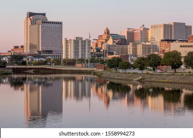 ROCHESTER, MN - OCTOBER 2019 - A Sunrise Skyline Shot of Rochester, Minnesota, Reflecting in Silver Lake during an Early Fall Morning