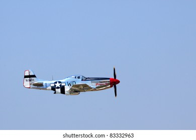 ROCHESTER, NY - JULY 17: A WWII era P-51 Mustang fighter airplane flying during a performance at an airshow in Rochester, New York on July 17, 2011.