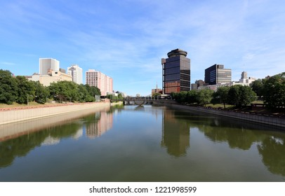ROCHESTER, NY, USA - JUNE 26: A view of the Rochester skyline from Genesee River in Rochester, New York on June 26, 2018. Rochester is a city in upstate New York.