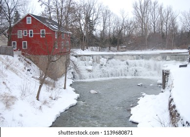 Rochester, NY/USA--January, 2014. A 19th century house beside a waterfall in winter.