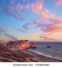 Rock Aphrodite near Petra tou Romiou in Cyprus, Paphos. Panoramic image of famous Cyprus landmark on romantic sunset with pink clouds.