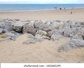 rock armour groynes at minehead, somerset with views to the horizon over the beautiful blue sea