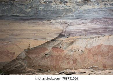 Rock art includes both humanoid and animal figures on cliffs above the Mekong estimated to be 3,000 years old at Pha Taem National Park in Ubon Ratchathani, Thailand