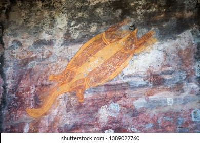 Rock art with turtle figure in Ubirr on the rugged rock shelters in the Kakadu National Park in Australia