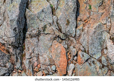 Rock background with cracks between the stones. Flagstone.