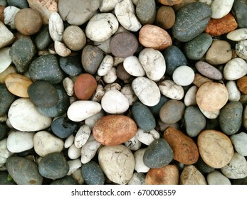 Rock backgrounds detail garden.Abstract background with dry grey round big and small sea stones.