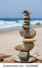 Rock balancing (cairn) on Aquinnah Beach, Martha's Vineyard, USA. Note the image has a narrow depth of field, focused on the foreground cairn