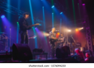 Rock band concert. Singer on stage. Abstract blurred image