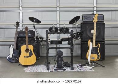 Rock band equipment in a suburban garage.