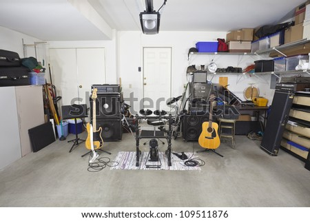 Rock band music equipment cluttered suburban stock photo edit now