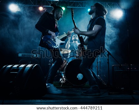 Rock band performs on