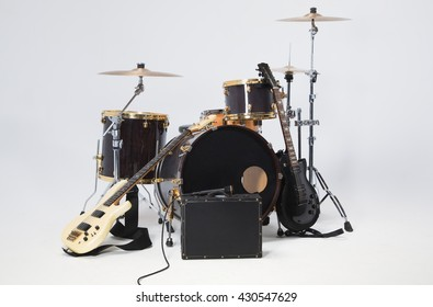 Rock Band, solo guitar, bass, drums, microphone on a black suitcase.