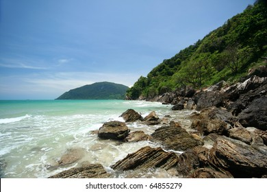 The rock beach in Khanom Bay,  Gulf of Thailand coast, Nakhon Si Thammarat province.