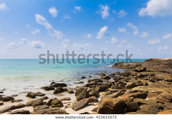 Rock beach over seacoast, natural landscape background
