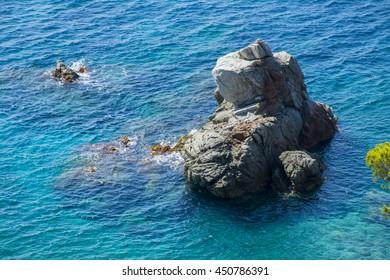 rock in the blue sea