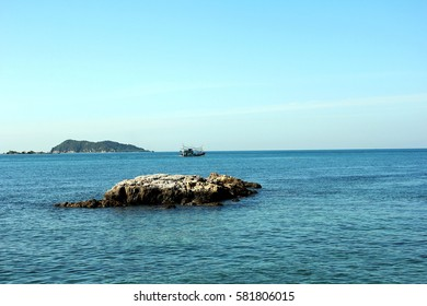 rock with blue sea and blue sky in Thailand