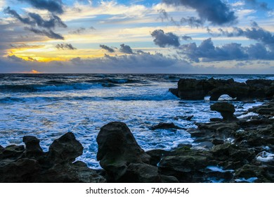Rock and boulder formations on the beach at daybreak
