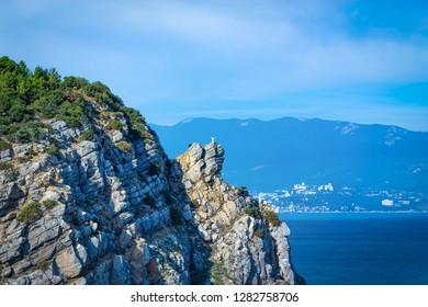 Rock of Breaker in Gaspra near the Swallow Nest in Crimea, background with vignette. Beautiful seascape.