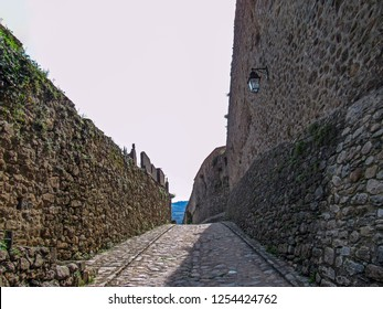 Rock brick walls and road around medieval town Prats-de-Mollo-la-Preste, Pyrenees-Orientales, Occitanie, southern France, Europe - Shutterstock ID 1254424762