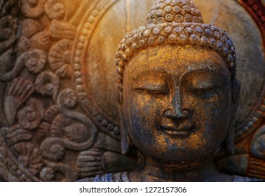 Rock Buddha statue with sunlight used for amulets of Buddhism religion. Buddhism is popular region in China Japan and south east Asia.copy space concept.