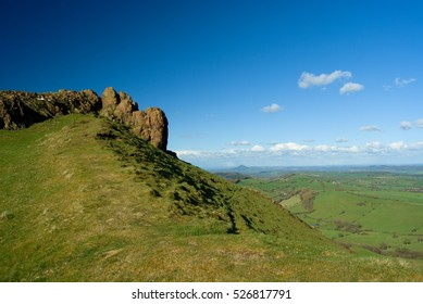 Rock of the Caer Caradoc, volcanic hill, english and welsh nature, blue polarised cloudy sky, springtime,border between England and Wales, Church Stretton, Shrewsbury, Shropshire Hills, United Kingdom