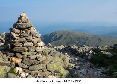 A rock cairn along the hiking trail on mount Washington.