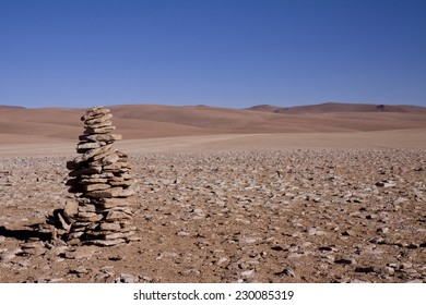 Rock cairn in front of lifeless landscape at 5000 meters, Potosi region of Bolivia