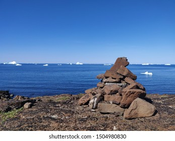 A rock cairn marks a trail in Greenland
