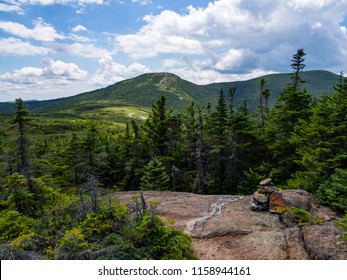 A rock cairn on an exposed section of mountain trail in the Appalachian Mountains in Maine, along the Appalachian Trail.