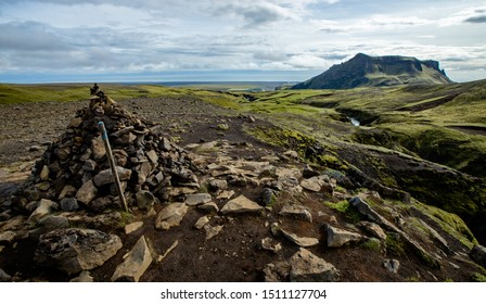 Rock cairn and scenic landscape view hiking highlands of Iceland
