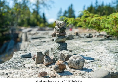 Rock cairns at granite quarry hiking trail in Stonington, Maine