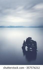 Rock in the calm sea