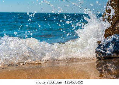Rock and Clear water of Cretan Sea front view,bounce off spread fling water