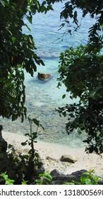 A rock in clear water, taken in Saleman Village, Manusela National Park, Seram island, Maluku, Indonesia