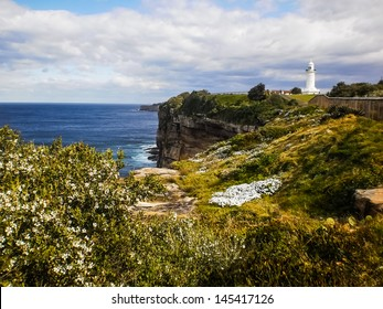 Rock cliff and lighthouse beside the sea at Sydney Australia
