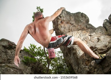 A rock climber ascending a bolder in Mpumalanga, South Africa.