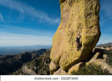 Rock climber climbing on the Goosehead formation on Mt Lemmon, Tucson, AZ