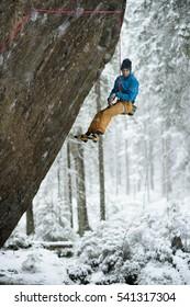 Rock climber. Extreme climbing. Unique winter sports. Scandinavian nature.