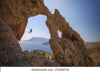 Rock climber falling of a cliff while lead climbing. Kalymnos Island, Greece
