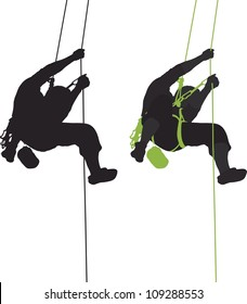 Rock climber hanging silhouette.