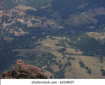 Rock climber relaxing at a peak on Mt. Diablo.