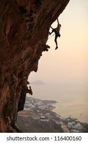 Rock climber at sunset, Kalymnos Island, Greece