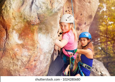 Rock climbers wearing helmets training outdoors