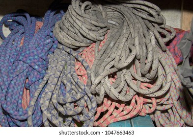 Rock climbing material, group of stored ropes, blue, red